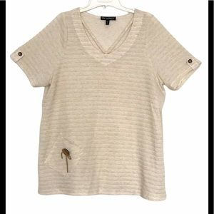 Soft dressy top with neck cutouts. Made in Canada.